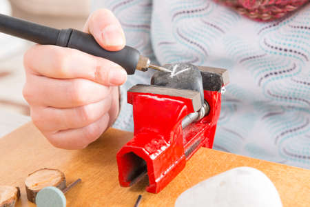 engraver: Using a high speed rotary multi tool to engrave ornament on the stone