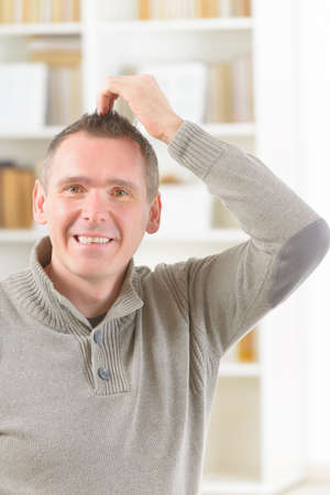 techniques: Man doing EFT on the top head point. Emotional Freedom Techniques, tapping, a form of counseling intervention that draws on various theories of alternative medicine. Stock Photo