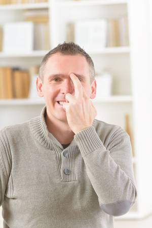 Man doing EFT on the eye brow point. Emotional Freedom Techniques, tapping, a form of counseling intervention that draws on various theories of alternative medicine. photo