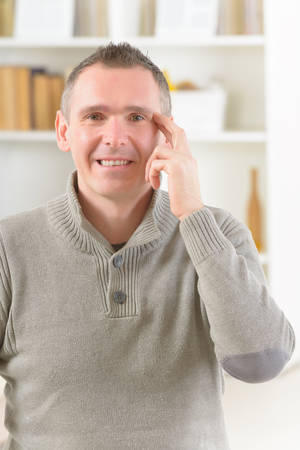 Man doing EFT on the side of eye point. Emotional Freedom Techniques, tapping, a form of counseling intervention that draws on various theories of alternative medicine. photo