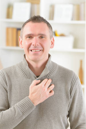 techniques: Man doing EFT on the under collarbone. Emotional Freedom Techniques, tapping, a form of counseling intervention that draws on various theories of alternative medicine.