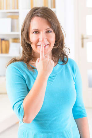 emotional freedom: Woman doing EFT on the under nose point. Emotional Freedom Techniques, tapping, a form of counseling intervention that draws on various theories of alternative medicine. Stock Photo