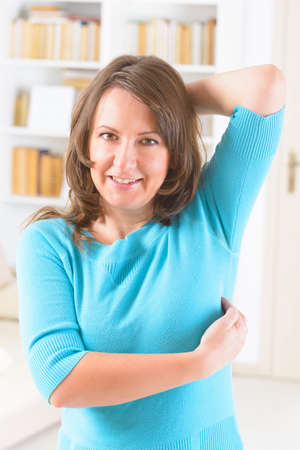 emotional freedom: Woman doing EFT on the under arm point. Emotional Freedom Techniques, tapping, a form of counseling intervention that draws on various theories of alternative medicine. Stock Photo