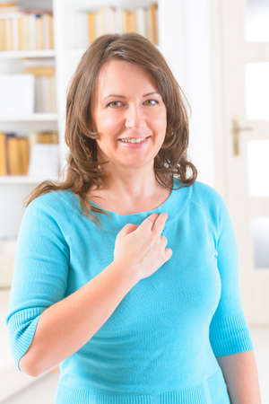 collarbone: Woman doing EFT on the under collarbone. Emotional Freedom Techniques, tapping, a form of counseling intervention that draws on various theories of alternative medicine.