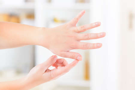 Woman doing EFT on the finger point. Emotional Freedom Techniques, tapping, a form of counseling intervention that draws on various theories of alternative medicine. 写真素材