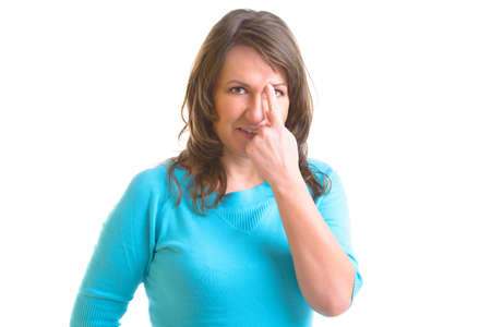 Woman doing EFT on the eye brow point. Emotional Freedom Techniques, tapping, a form of counseling intervention that draws on various theories of alternative medicine. Stock Photo