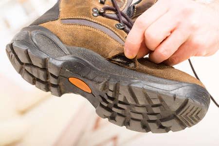 scuffed: Hole in worn old shoe