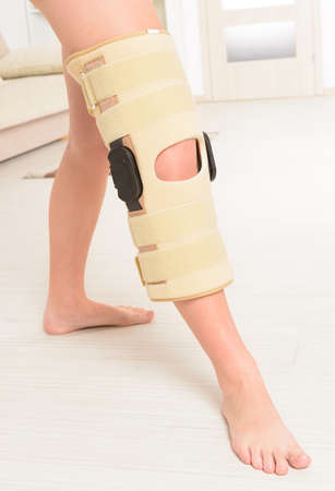 neoprene: Womans leg in knee cages for stabilization and support Stock Photo
