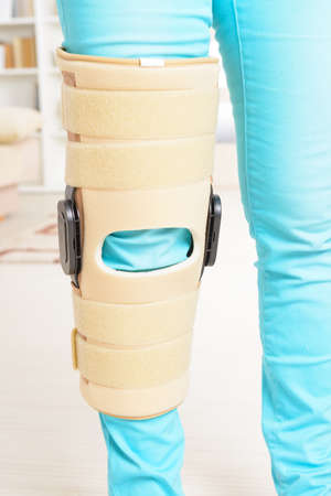 therapeutical: Womans leg in knee cages for stabilization and support Stock Photo