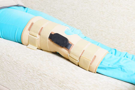 stabilization: Womans leg in knee cages for stabilization and support Stock Photo