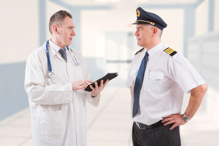 faa: Airplane pilot during medical exam with doctor