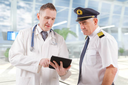 Commercial airplane pilot with doctor photo
