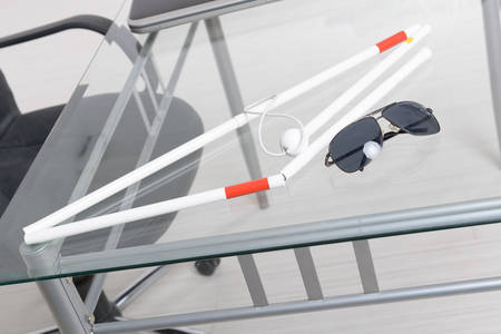 blind person: White stick and dark glasses for blind person