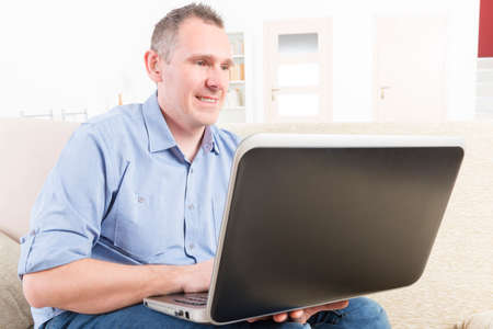 impaired: Hearing impaired man working with laptop at home or office