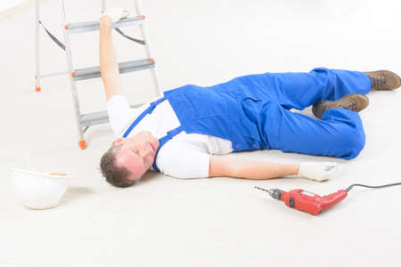 accident dead: Man worker laying on a floor, concept of accident at work