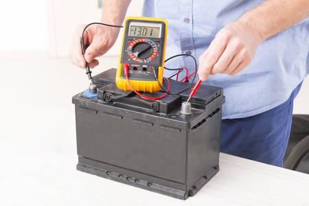 voltage: Testing car battery with digital multimeter