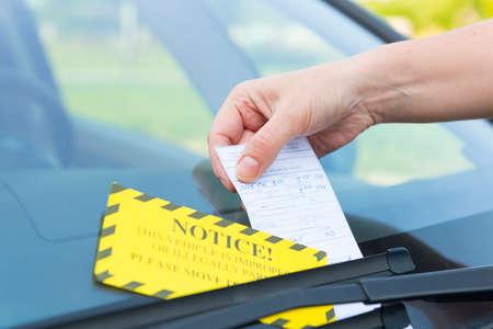 parking ticket: Parking ticket placed under windshield wiper Stock Photo