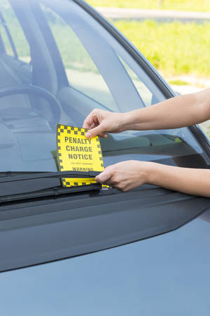 illegally: Parking ticket placed under windshield wiper Stock Photo
