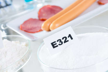 stabilizers: Preservatives substances that are added to products such as foods, pharmaceuticals, paints, biological samples, wood etc. to prevent decomposition by microbial growth or by undesirable chemical changes. Butylated hydroxytoluene E321 Stock Photo