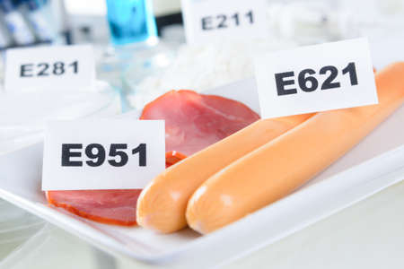 E951 Aspartame ASM. E621 Monosodium glutamate MSG, additives to food. Stock Photo