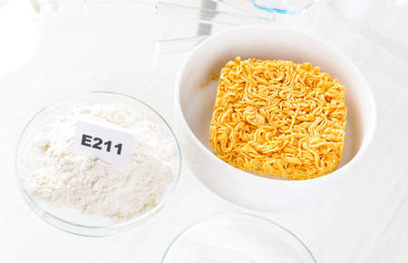 E211 Sodium benzoate. Preservatives substances that are added to products such as foods, pharmaceuticals, etc. to prevent decomposition by microbial growth or by undesirable chemical changes. Stock Photo