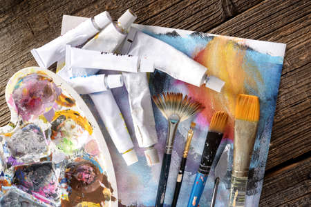 painter palette: Professional acrylics paints in tubes with a painter palette