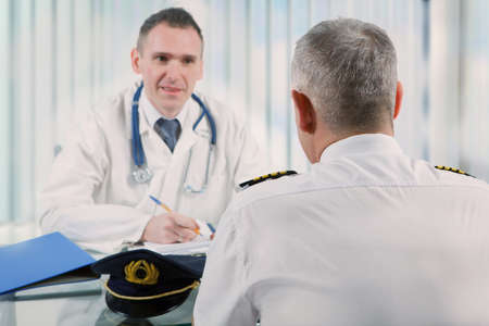 Airplane pilot during medical exam with doctor