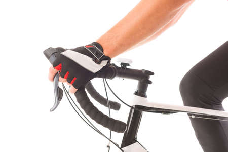 hand brake: Hands in gloves on bicycles handlebars