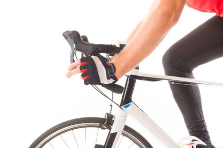 shifting: Hand in glove shifting bicycles gears Stock Photo