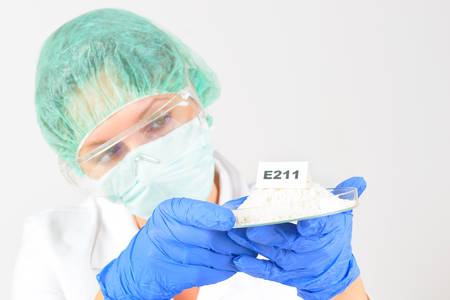 Researcher presenting preservatives substances that are added to products such as foods, pharmaceuticals, paints, biological samples, wood etc. Stock Photo