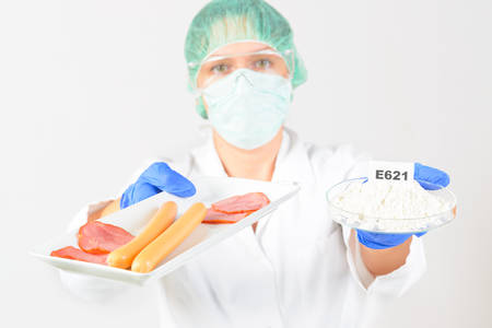 preservatives: Researcher presenting preservatives substances that are added to products such as foods, pharmaceuticals, paints, biological samples, wood etc. Stock Photo