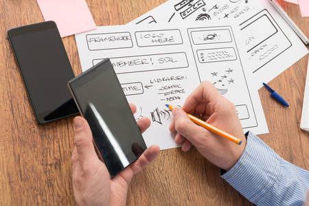 interface design: Designer working at new mobile applications