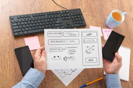 website plan: Designer working at new mobile applications