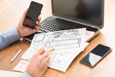 application: Designer working at new mobile applications