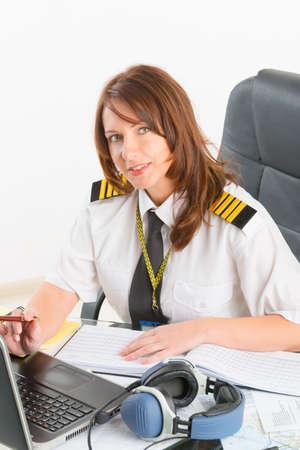 epaulettes: Beautiful woman pilot wearing uniform with epaulettes doing preflight briefing