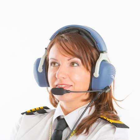 Belle femme pilote avec casque utilisé dans les avions Banque d'images - 50304034