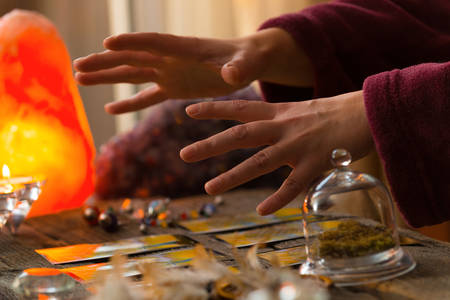Fortune teller hands over tarot cards Stock Photo