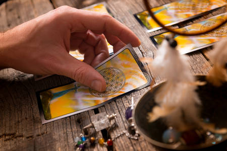 astrologist: Fortune teller holding a tarot card Stock Photo