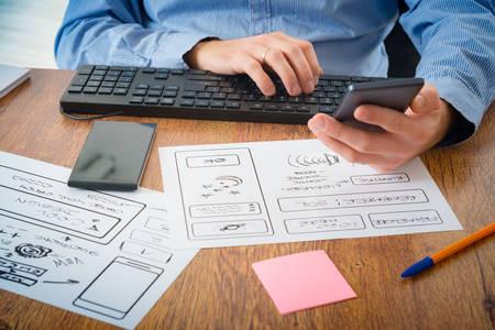 developer: Designer working at new mobile applications