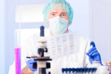 identification: Scientist analizing DNA sequence Stock Photo