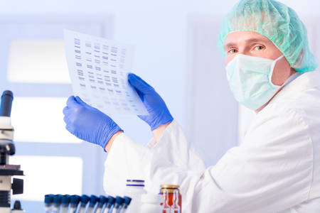 sequencing: Scientist analizing DNA sequence Stock Photo