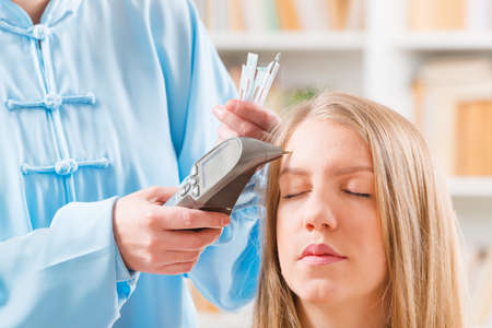 eastern medicine treatment: Finding an acupuncture point with electronic device which could be also used to apply lectroacupuncture, PENS Stock Photo