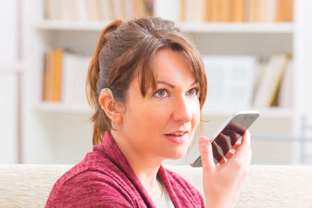 sign language: Smiling Deaf woman talking using sign language on the smartphones cam Stock Photo