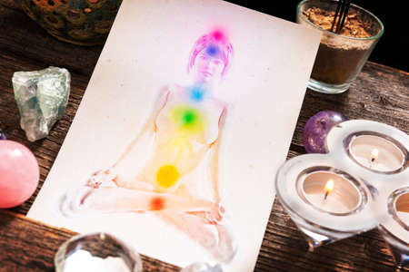 reiki symbol: Chakras illustrated over human body with natural crystals