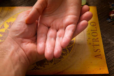 Foretelling the future through the study of the palm and astrology
