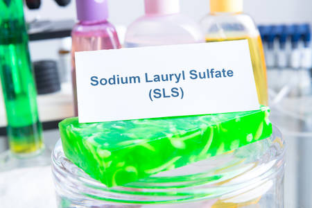 Noxious additives in cosmetics, SLS. Laboratory with chemical substances. Stock Photo