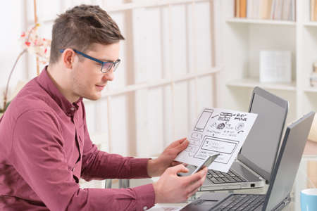 Designer or programmer working at new mobile applications Stock Photo