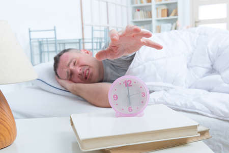 sleepless: Sleepless, awaken man in bed at home