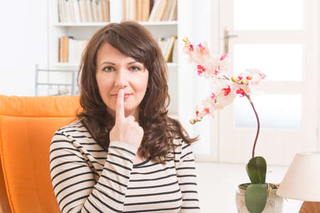 tapping: Woman doing EFT on the under nose point. Emotional Freedom Techniques, tapping, a form of counseling intervention that draws on various theories of alternative medicine. Stock Photo
