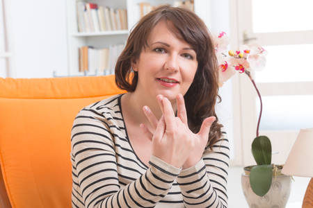 theories: Woman doing EFT on the finger point. Emotional Freedom Techniques, tapping, a form of counseling intervention that draws on various theories of alternative medicine. Stock Photo